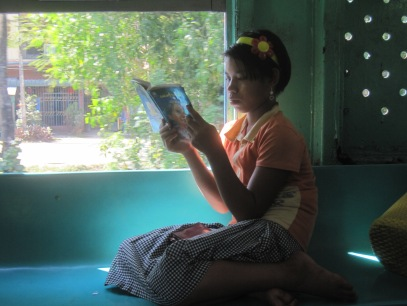 quietly reading as the train draws back into Yangon central Station
