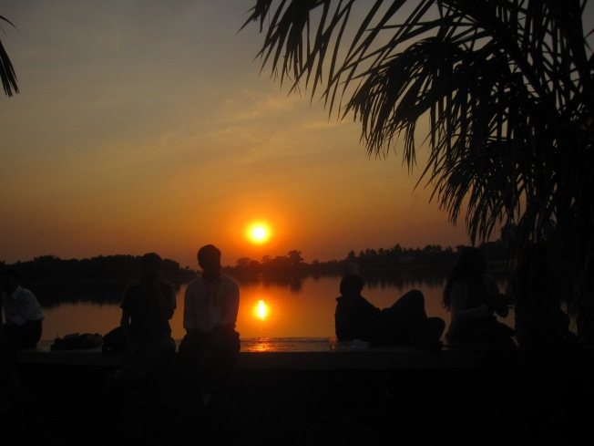 Listening to poetry at Irradaddy LIterary Festival,  as the sun setts on Inya Lake