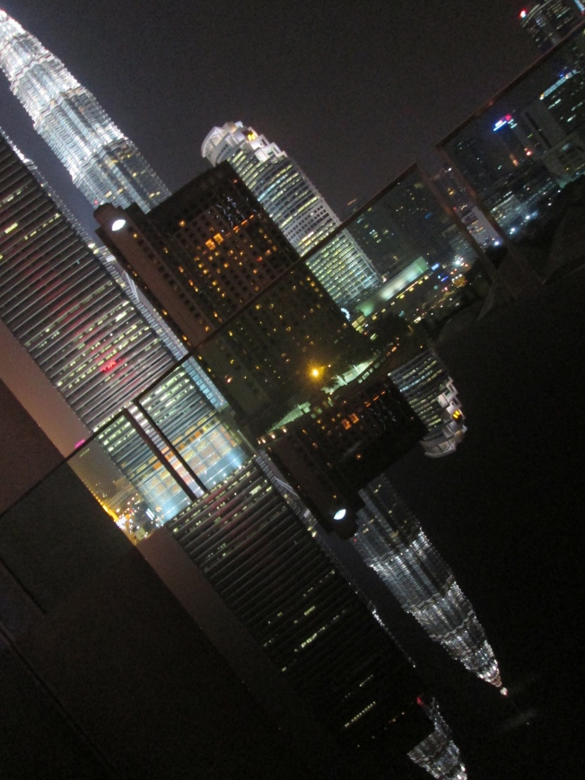 Reflection of the iconic Petronas Towers in Kuala Lumpur