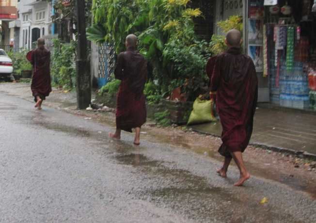 alms collecting in the rain