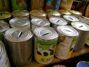 Creativity - old tins refashioned into savings banks.  Even though we have no coins in use!