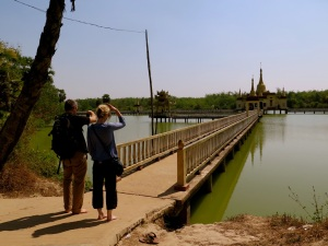 A pause before venturing across the bridge towards the snake temple